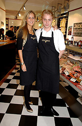 MISS ANNABEL BUCHANAN and HARRY GRENFELL at the opening of Jack O'Shea's butcher, Montpelier Street, London on 9th November 2006.  <br />