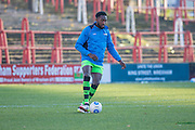 Forest Green Rovers Manny Monthe(3) warming up during the Vanarama National League match between Wrexham FC and Forest Green Rovers at the Racecourse Ground, Wrexham, United Kingdom on 26 November 2016. Photo by Shane Healey.