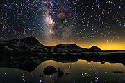 An arm of the Miky Way Galaxy arcs above a mountain peak in the High Sierra also reflected in L Lake on a moonless night, July 1, 2016. (Photo by Scott Sady)