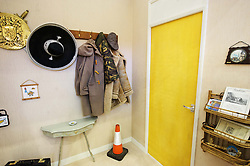 © Licensed to London News Pictures. 15/03/2013 London, UK.  A view of a replica of Dell Boy's famous Peckham flat hallway at the Ideal Home Show 2013. The Trotters Only Fools and Horses residence has been given a modern makeover by Celebrity designer George Clarke. .Photo credit : Simon Jacobs/LNP