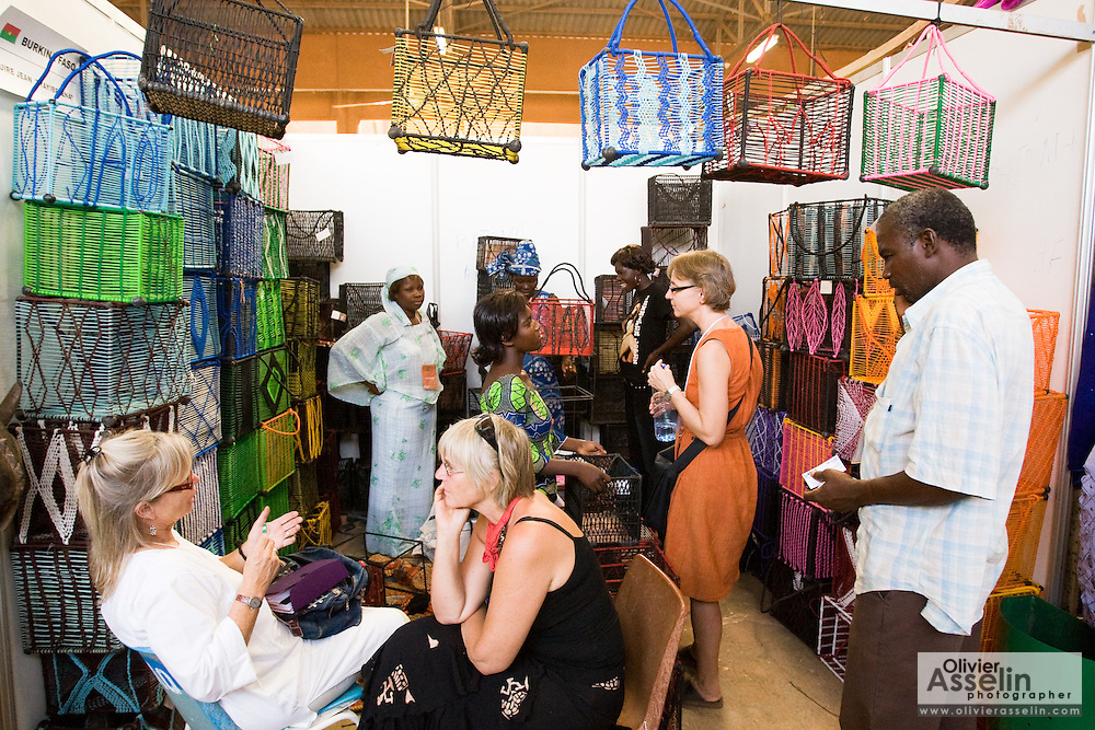 Visitors browse in a booth selling baskets at the 22nd Salon International de l'Artisanat de Ouagadougou (SIAO) in Ouagadougou, Burkina Faso on Sunday November 2, 2008.
