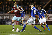 Scott Malone of Cardiff City challenges Scott Arfield of Burnley during the Sky Bet Championship match between Burnley and Cardiff City at Turf Moor, Burnley, England on 5 April 2016. Photo by Simon Brady.
