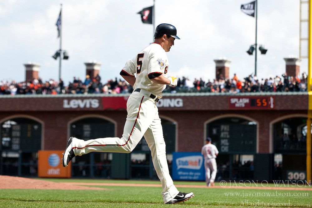 April 8, 2011; San Francisco, CA, USA;  San Francisco Giants left fielder Pat Burrell (5) rounds the bases after hitting a home run against the St. Louis Cardinals during the sixth inning at AT&T Park.  San Francisco defeated St. Louis 5-4 in 12 innings.