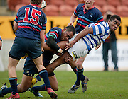 Fraser Tech's Maru Henry is tackled during the Waikato Club Rugby Final - Fraser Tech v Morrinsville Sports, won 19-15 by Fraser Tech at Waikato Stadium, Hamilton, New Zealand, Saturday 31 July 2010. Photo: Stephen Barker/PHOTOSPORT
