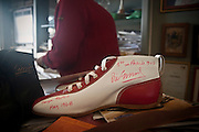 Cefal&ugrave;:la bottega di Ciccioshoes , uno dei modelli di Ciccio alias  Francesco Liberto con gli autografi dei piloti ,  il calzoaio Ciccio &egrave; iscritto dall&rsquo;UNESCO fra i Tesori Umani Viventi nel Libro dei Saperi del Registro delle Eredit&agrave; Immateriali.<br /> Cefal&ugrave;:Ciccio shoes shop, one pair of shoes created by Ciccio with the autographs of racing drivers, Ciccio, whose real name is Francesco Liberto is registered with the UNESCO Living Human Treasures in the Book of Knowledge of the Register of Intangible Heritage,