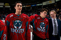 KELOWNA, CANADA - MARCH 16: Alex Swetlikoff #17, Cole Carrier #12 and Lassi Thompson #2 of the Kelowna Rockets line up for the shirt off your back presentation after the OT win against the Vancouver Giants on March 16, 2019 at Prospera Place in Kelowna, British Columbia, Canada.  (Photo by Marissa Baecker/Shoot the Breeze)