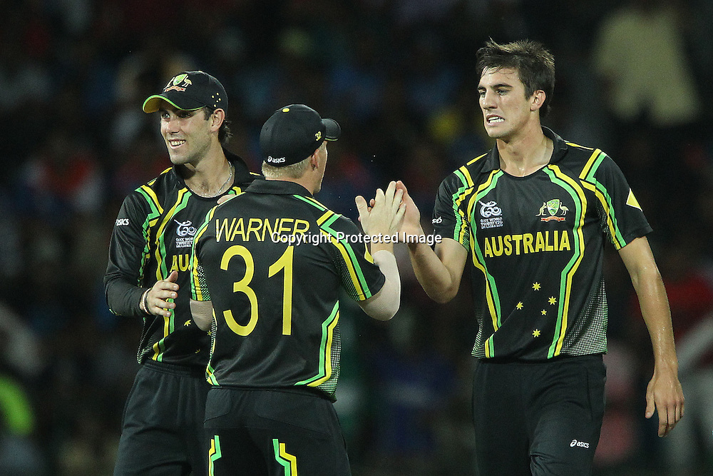 Patrick Cummins and David Warner celebrate the wicket of Gautam Gambhir during the ICC World Twenty20 Super 8s match between Australia and India held at the Premadasa Stadium in Colombo, Sri Lanka on the 28th September 2012<br /> <br /> Photo by Ron Gaunt/SPORTZPICS