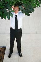 Businessman Standing under Tree
