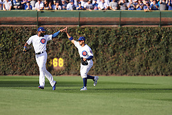 October 9, 2017 - Chicago, IL, USA - Chicago Cubs center fielder Jon Jay (30), right, is congratulated by Chicago Cubs right fielder Jason Heyward (22) after Jay made a great catch to end the top of the fourth inning of Game 3 of a National League Division Series playoff on Oct. 9, 2017 at Wrigley Field in Chicago. (Credit Image: © Christopher Sweda/TNS via ZUMA Wire)