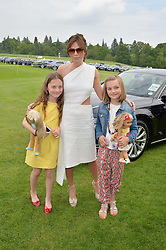 ANNA FRIEL with her daughter GRACIE (in yellow) and SIDNEY BREMNER at the St.Regis International Polo Cup at Cowdray Park, Midhurst, West Sussex on 17th May 2014.
