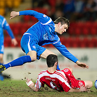 St Johnstone v Brechin....22.03.11  Scottish Cup Quarter Final replay<br /> Murray Davidson tackled by Craig Molloy<br /> Picture by Graeme Hart.<br /> Copyright Perthshire Picture Agency<br /> Tel: 01738 623350  Mobile: 07990 594431