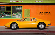 Image of a yellow classic vintage sports car in Costa Mesa, California, Ferrari Dino 246 GT coupe,  American west coast, property released.