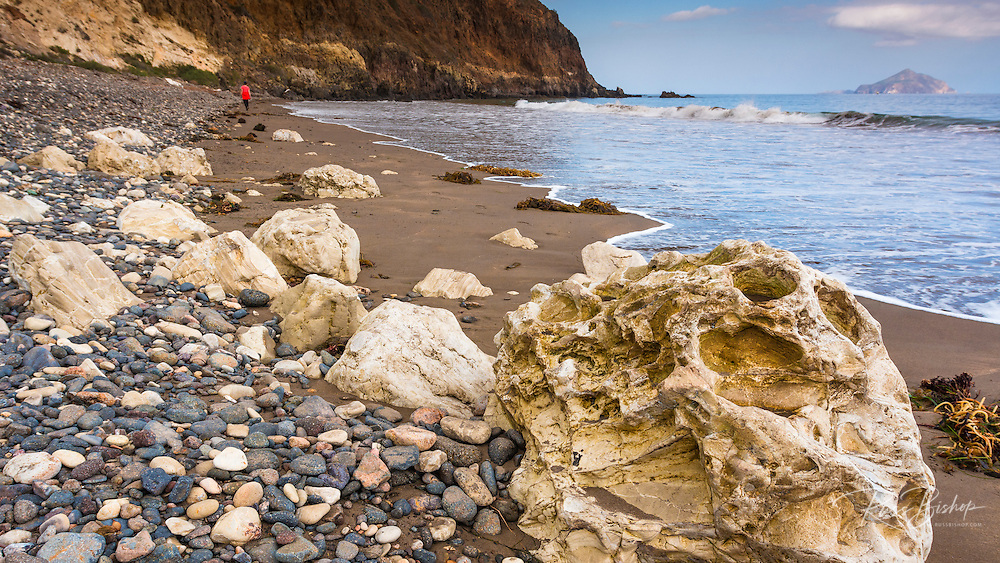 Beachcombing at Smugglers Cove, Santa Cruz island, Channel Islands National Park, California USA