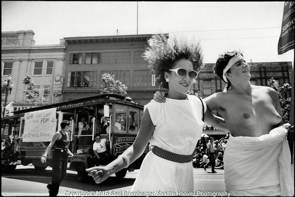 'PRIDE: Parade, Prom, Community'<br /> <br /> Our Exhibit at the PhotoCentral Gallery in Hayward, from 10.11.2014 - 12.6.2014. <br /> <br /> In the exhibit we combined our documentary photo essay about the 'San Francisco Gay &amp; Lesbian Freedom Day Parade: 1984-1990,' with portraits of LGBTQ teens who we did portraits of at 'The 20th Annual Hayward Gay Prom' on June 7th, 2014. <br /> <br /> Our goal was to show what it was like 25-30 years ago when the gay community was marching for it's civil rights, fighting AIDS, and coming together as a community; and, what's it's like now for many LGBTQ teens who we found to be confident, open, and happy to be who they are.