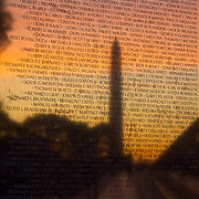 Sunrise and the Washington Monument reflect off the Vietnam Veterans Memorial and the names of those servicemen and women who fought and died in the Vietnam War or are still unaccounted for.