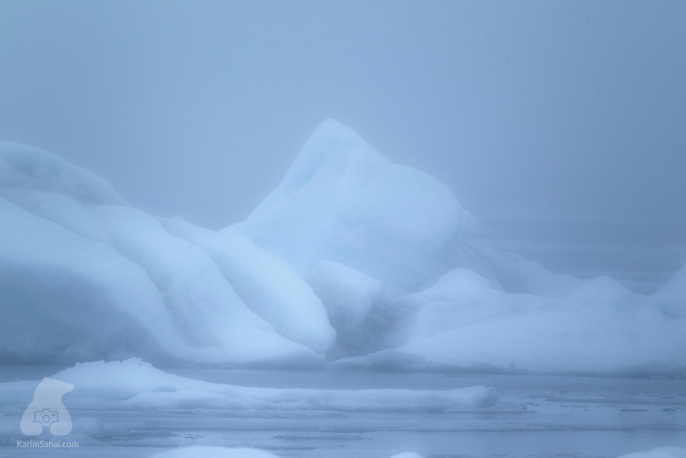 Iceberg in the fog in the north of Spitsbergen island, Svalbard