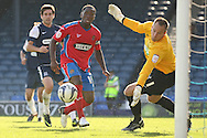 Picture by David Horn/Focus Images Ltd +44 7545 970036.08/09/2012.Abu Ogogo, Captain of Dagenham and Redbridge watches his shot go wide during the npower League 2 match at Roots Hall, Southend.