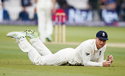 England's Jos Buttler looks up after a ball went past his grasp during day two of the First NatWest Test Series match at Lord's, London.