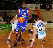 Saints import Kareem Johnson drives past Arthur Trousdell. NBL - Wellington Saints v Bay Hawks at TSB Bank Arena, Wellington, New Zealand on Friday, 3 June 2011. Photo: Dave Lintott / photosport.co.nz