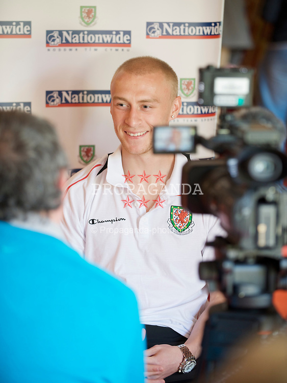 CARDIFF, WALES - Tuesday, March 24, 2009: Wales' David Cotterill is interviewed during a media session at the Vale of Glamorgan Hotel ahead of the 2010 FIFA World Cup Qualifying Group 4 match against Finland. (Pic by David Rawcliffe/Propaganda)