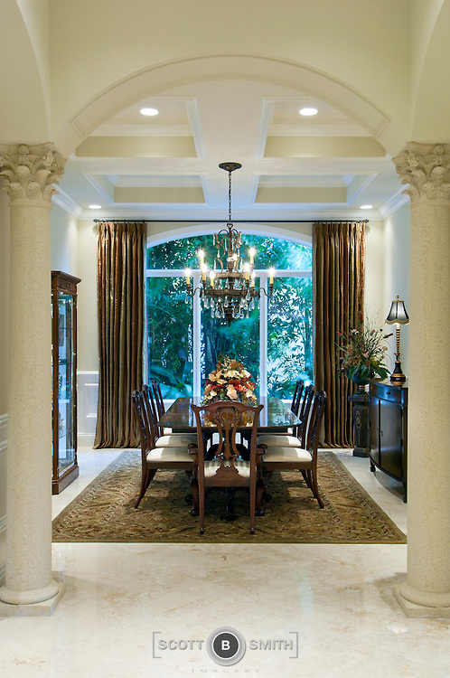 Luxury Florida Waterfront Home Dining Room With Archway Entrance And Columns