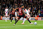 Callum Wilson (13) of AFC Bournemouth is unable to connect with a pass from Nathan Ake (5) of AFC Bournemouth and misses a chance to score during the Premier League match between Bournemouth and Crystal Palace at the Vitality Stadium, Bournemouth, England on 1 October 2018.