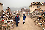 Residents looks for their belongings amongst the debris of their destroyed homes in the town of Rikuzen Takada where the earthquake and tsunami hit on 11 March 2011.