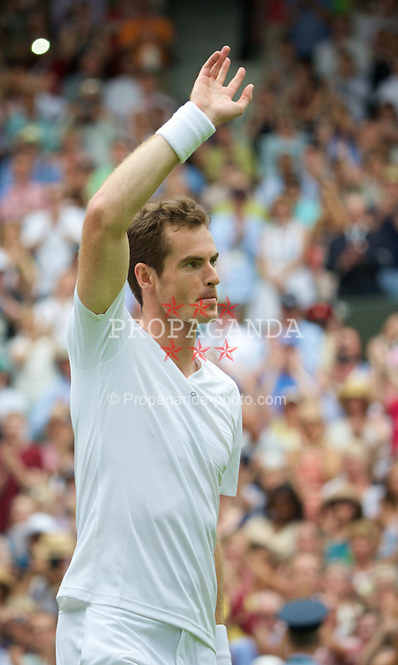 LONDON, ENGLAND - Monday, June 23, 2014: Andy Murray (GBR) waves as he leave the court during the Gentlemen's Singles 1st Round match on day one of the Wimbledon Lawn Tennis Championships at the All England Lawn Tennis and Croquet Club. (Pic by David Rawcliffe/Propaganda)
