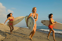 Young Women Surfers with Surfboards