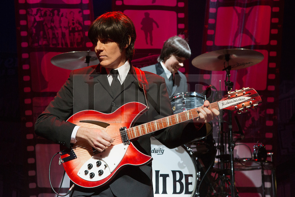 """© Licensed to London News Pictures. 17/09/2012. London, England. With John Brosnan as """"John"""", Michael Gagliano as """"George"""", Ian B Garcia as """"Paul"""" and Phil Martin as """"Ringo"""". Celebration of the 50th Anniversary of the world's most successful rock'n'roll band with a spectacular theatrical concert jam-packed with over twenty of The Beatles' greatest hits! Photo credit: Bettina Strenske/LNP"""