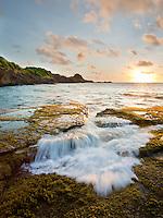Early morning light adds a glow to the incoming Caribbean surf.  St. Lucia.