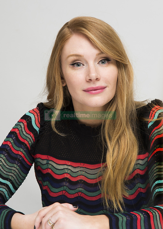 December 5, 2016 - Hollywood, California, U.S. - BRYCE DALLAS HOWARD promotes movie 'Gold.' Bryce Dallas Howard (born March 2, 1981) is an American film actress, director, producer, and writer. Daughter of Ron Howard. Howard attended New York University's Tisch School of the Arts, but would ultimately leave before graduating to take on roles on broadway. During a performance of 'As You Like it' where Bryce portrayed Rosalind, 'The Village' (2004) and then in the fantasy thriller 'Lady in the Water' (2006). Her performance in K. Branagh's film adaptation of 'As You Like It' (2006), earned her a Golden Globe Award nomination. In 2006, she co-wrote and directed the short film Orchids. Howard became more recognizable to audiences as Victoria in 'The Twilight Saga: Eclipse' (2010). This project, as well as 'Terminator Salvation' (2009), was financially successful, but both films garnered mixed reviews from the press. In 2011, she had supporting roles in '50/50' and 'The Help'. She also played a lead role, Claire Dearing, in the science fiction adventure film 'Jurassic World' (2015), the fourth installment in the 'Jurassic Park' film series and her most financially successful film to date. In 2016 she signed on to reprise her role in the sequel to 'Jurassic World' (2018). (Credit Image: © Armando Gallo via ZUMA Studio)