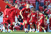Liverpool defender Andrew Robertson (26) and Liverpool midfielder Jordan Henderson (14) warming up during the Premier League match between Liverpool and Arsenal at Anfield, Liverpool, England on 24 August 2019.