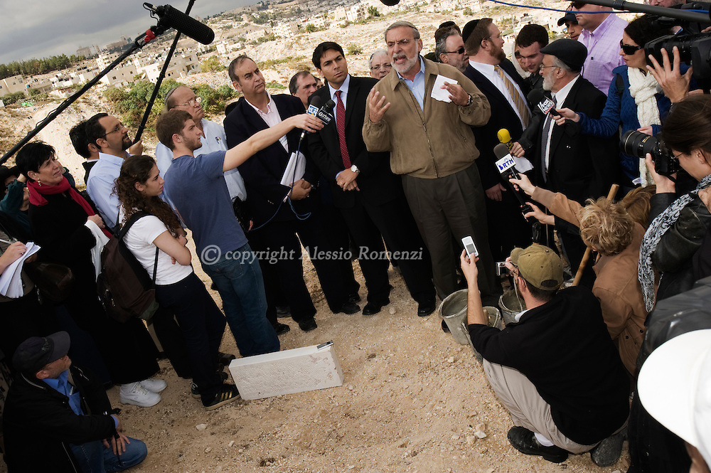 Right wing Israelis and a US Jewish delegation led by New York State Assembly man Dov Hikind (C) lay a symbolic cornerstone of a new part of the Nof Tzion settlement in the Arab east Jerusalem neighborhood of Jabel Mukaber on November 18, 2009. Israel's decision to press ahead with the construction of new settlements in East Jerusalem could be 'very dangerous,' US President Barack Obama said in an interview with Fox News..© ALESSIO ROMENZI