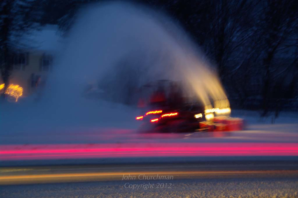 snowblower clears highway