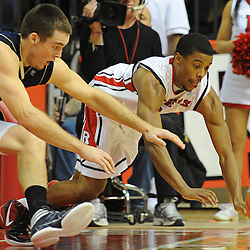 Rutgers Scarlet Knights guard Jerome Seagears (1) and Notre Dame Fighting Irish guard/forward Pat Connaughton (24) drive for a loose ball during Big East NCAA action during Rutgers' 65-58 victory over Notre Dame at the Louis Brown Athletic Center in Piscataway, N.J.