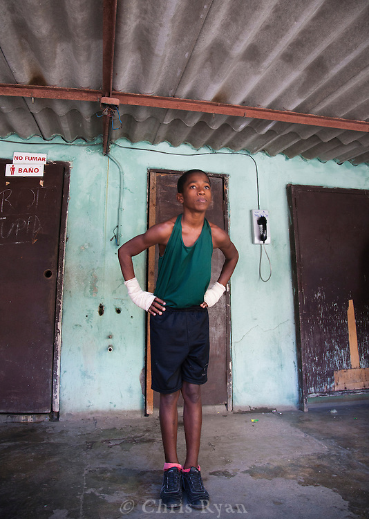 Young boxer warming up under the bleachers for a match, Havana, Cuba