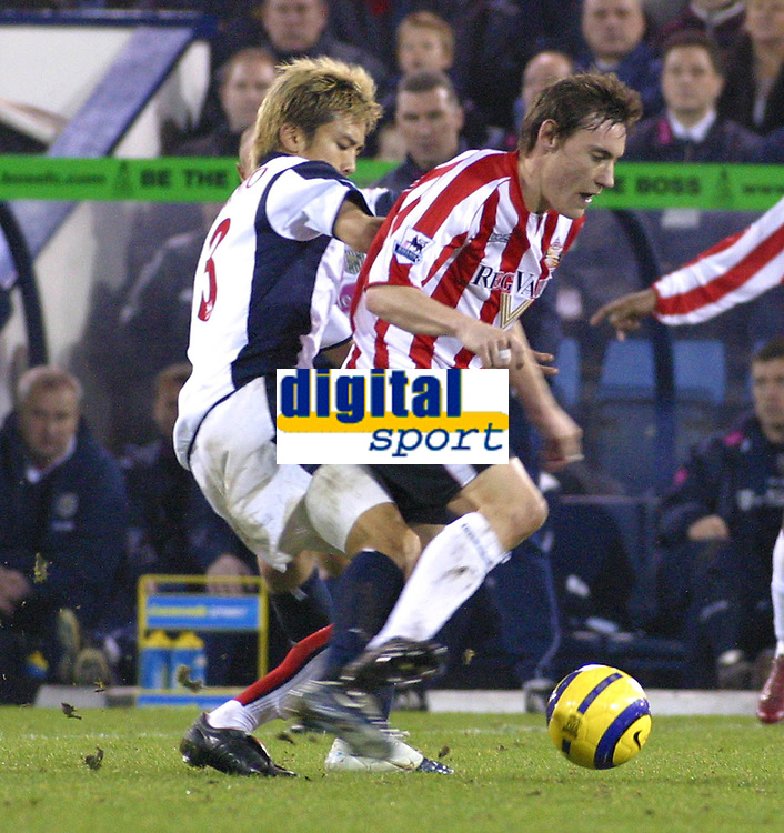 Photo: Dave Linney.<br />West Bromwich Albion v Sunderland. The Barclays Premiership. 21/01/2006.West Brom's Junichi Inamoto(L)<br />keeps a close eye on Dean Whitehead