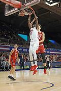 SMU Mustangs guard Emmanuel Bandoumel (5) dunks on Hartford Hawks forward Miroslav Stafl (12) while D.J. Mitchell (2) looks on during an NCAA college basketball game, Wednesday, Nov. 27, 2019, in Dallas.SMU defeated Hartford 90-58. (Wayne Gooden/Image of Sport)