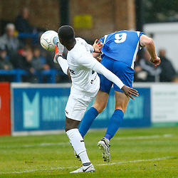 Salford's forward Adam Rooney heads the ball past Dovers midfielder Nortei Nortey for his second goal during the National League match between Dover Athletic FC and Salford City FC at Crabble Stadium, Kent on 06 October 2018. Photo by Matt Bristow.
