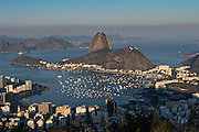 Sugarloaf Mountain and Guanabara Bay from Mirante Dona Marta in evening light in Rio de Janeiro, Brazil.