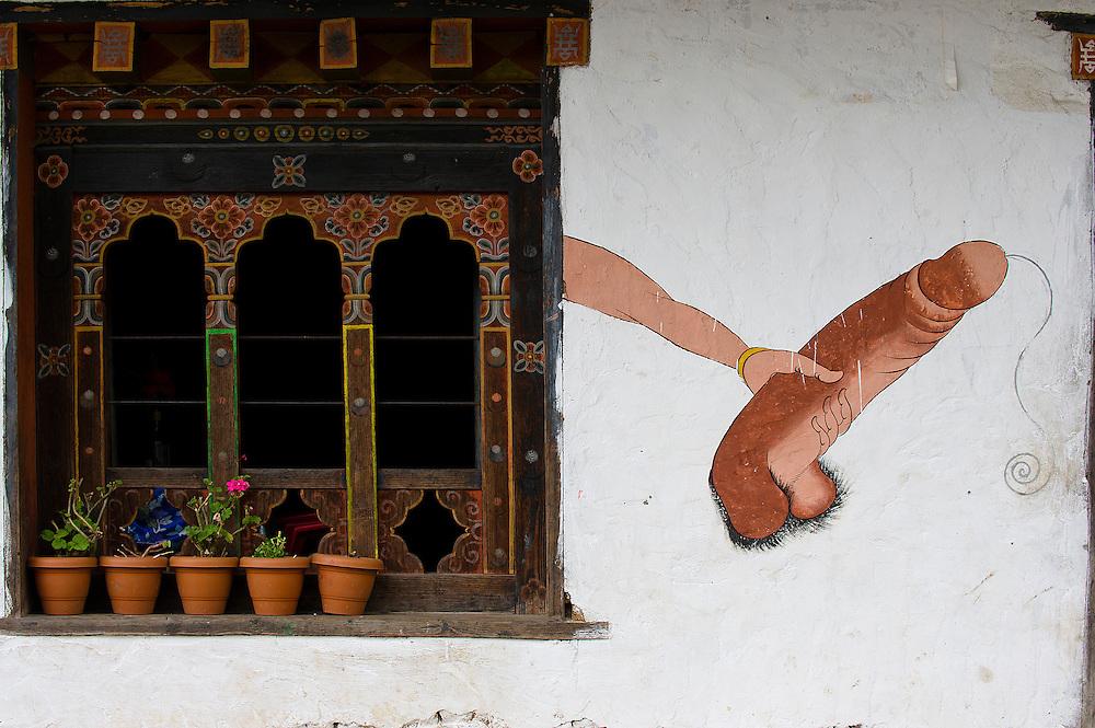 Phallic decorations on a house of Thanley Gang, Bhutan. A guarantee of fruitfulness or protection against the demons? Village of Thanley Gang, Bhutan.