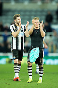 Newcastle United midfielder Matt Ritchie (#11) celebrates with Newcastle United defender Jamaal Lascelles (#6) following Newcastle United's victory over Derby County (1-0) in the EFL Sky Bet Championship match between Newcastle United and Derby County at St. James's Park, Newcastle, England on 4 February 2017. Photo by Craig Doyle.