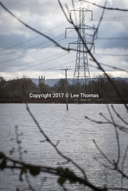Gloucestershire, Worcestershire, UK. 5th January 2018. River Severn water levels remain high in Gloucestershire and Worcestershire as the Environment Agency issues over a hundred flood warnings for England. Maisemore and Sandhurst in Gloucestershire are at particular risk of imminent flooding according to the Agency with high water levels peaking at around midday today. Pictured:  Flooded fields near Maisemore with Gloucester Cathedral in the distance.  // Lee Thomas, Tel. 07784142973. Email: leepthomas@gmail.com  www.leept.co.uk (0000635435)