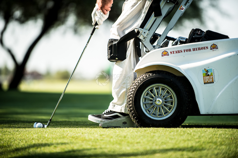 A photograph of a golfer who uses an adaptive golf cart