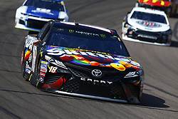 March 11, 2018 - Avondale, Arizona, United States of America - March 11, 2018 - Avondale, Arizona, USA: Kyle Busch (18) brings his car through the turns during the Ticket Guardian 500(k) at ISM Raceway in Avondale, Arizona. (Credit Image: © Chris Owens Asp Inc/ASP via ZUMA Wire)