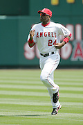 ANAHEIM, CA - APRIL 26:  Center fielder Gary Matthews Jr. #24 of the Los Angeles Angels of Anaheim runs while warming up before the game against the Tampa Bay Devil Rays at Angel Stadium in Anaheim, California on April 26, 2007. The Angels defeated the Devil Rays 11-3. ©Paul Anthony Spinelli *** Local Caption *** Gary Matthews Jr.