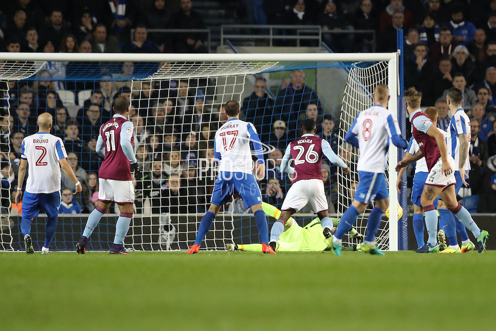 Aston Villa defender Nathan Baker (2) scores a goal 1-0 during the EFL Sky Bet Championship match between Brighton and Hove Albion and Aston Villa at the American Express Community Stadium, Brighton and Hove, England on 18 November 2016.