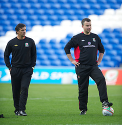 CARDIFF, WALES - Tuesday, August 9, 2011: Wales' manager Gary Speed MBE and assistant manager Raymond Verheijen during a training session at the Cardiff City Satdium ahead of the International Friendly match against Australia. (Photo by David Rawcliffe/Propaganda)