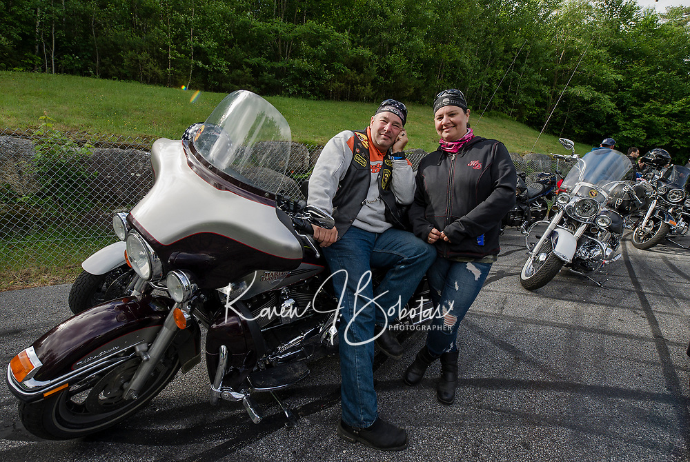 "Jay Belfiore of Albany, NY and Lucia Medeiros of Boston, MA gather with fellow riders for the annual ""Ride to the Sky"" with the Winnipesaukee Chapter of Harley Davidson owners on Thursday morning at Laconia Harley in Meredith.  (Karen Bobotas/for the Laconia Daily Sun)"